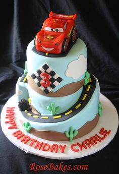 """Cars 2 Lightning McQueen Cake - This cake was based on the Disney Pixar Cars 2 movie! It's a special shaped carved design - almost """"wonky""""! Details here..."""