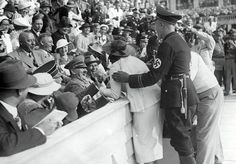 Hitler Reacts to Kiss from Excited American Woman at the Berlin Olympics, August 15, 1936 [1000x697] : HistoryPorn
