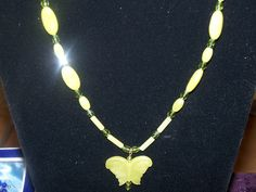 "Peridot butterfly pendant on 16"" necklace. We can also make this in 18"" with gold or silver clasp."