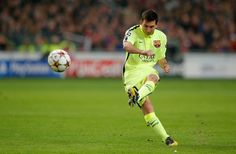 Lionel Messi of Barcelona takes a free kick during the UEFA Champions League Group F match between AFC Ajax and FC Barcelona at The Amsterdam Arena on November 5, 2014 in Amsterdam, Netherlands.
