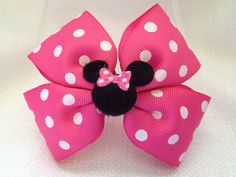 Hot Pink polka dot minnie mouse hairclip. This is for 1 pink minnie mouse hair…