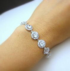 bridal bracelet wedding jewelry prom party gift christmas bridesmaid rhodium white gold halo pave Clear white round cubic zirconia bracelet This matches earrings and a necklace I have…I must have this bracelet by DesignByKara Prom Jewelry, Bridesmaid Jewelry, Body Jewelry, Wedding Jewelry, Jewelry Sets, Silver Jewelry, Unique Jewelry, Silver Ring, Jewelry Party
