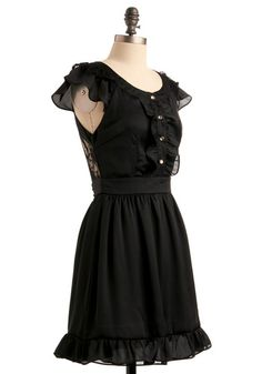 Little black dress with vintage, flirty, frilly twist. :)