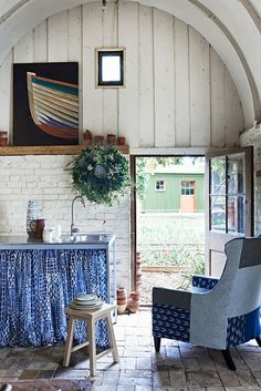blue fabrics and boat painting