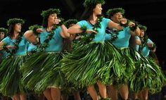 Ti leaf skirts and leis worn in a hula performance.