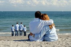 I love this idea with mom and dad hugging and the kids standing by the water.