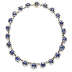 sapphire and diamond cluster necklace. it's like wearing a lot of kate middletons around your neck.