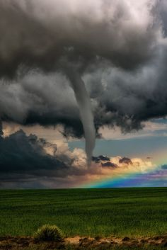 Weather - Tornado in front of a Rainbow - A beautiful shot of a tornado forming in front of a rainbow. This was a rare meteorological event witnessed near Lamar, CO.