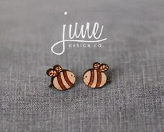 Wooden Bee Earrings Hi there! Thanks for stopping by :) • Laser cut from cherry wood • 9mm x 10mm • Surgical Steel backs • Unvarnished Made in