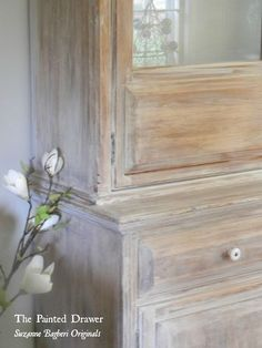 Adding a wash of Annie Sloan Old White on a farmhouse cabinet with video tutorial included.