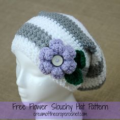 This flower slouchy hat is just too cute! You have to make sure to tell your friends about it. It has stripes all the way down, ribbed edging, and the cutest flower with 2 leaves!