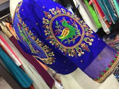 Beautiful royal blue color designer blouse with floret lata and bird design hand embroidery thread and kundan work on sleeve. Fancy Blouse Designs, Bridal Blouse Designs, Embroidery Neck Designs, Embroidery Thread, Maggam Work Designs, Pattu Saree Blouse Designs, Designer Blouse Patterns, Work Blouse, Sleeve Designs