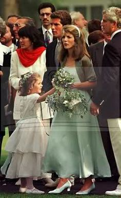 Caroline Kennedy & Rose Schlossberg, maid of honor and flower girl at the wedding of their cousin Anthony Radziwill. Also in the picture, best man John F. Kennedy Jr, and family friend (and JFK Jr's housemate at Brown University) Christiane Amanpour (red scarf).