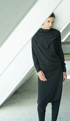Bold and flashy are too different things and this top proves it. The bold asymmetrical cuts and stitches coupled with the soft cotton in classic black,