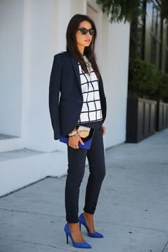 Pair a black and white printed blouse with a navy blazer. Make your look pop with cobalt accessories with a hit of metallic detail.