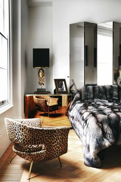sexiest. bedroom. ever. // #furs and #metallics and #mirrors, oh my.