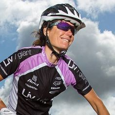"""Kelli Emmett: Professional cyclist and cycling coach. """"I love the challenge and the adventure of tackling a new trail or riding somewhere new. And most of all, I just love the feeling of being outdoors and exploring places on my bike."""""""