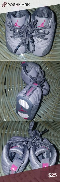 Baby Jordans Dark and light grey with pink detail. Size 1C. New without tags. Jordan Shoes Baby & Walker