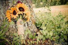 Wildflower bouquet I love the sunflowers and have my bridesmaids wear purple dresses would look AMAZING!!