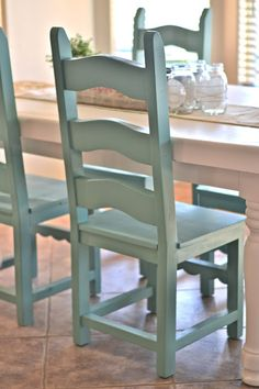 The white is Swiss Coffee by Glidden and the chairs are spray painted in Jade by Krylon.