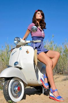 Vespa girl with fashion summer clothes and sandals