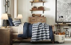 bracket shelves above low dresser, giant city map, weathered wood nightstand