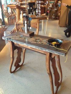 Cool! Well whadaya know! Two fancy chair backs made into table legs!