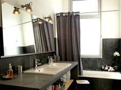 Un coquillage près d'une orchidée : Accessoires pour une salle de bains déco - Journal des Femmes Décoration
