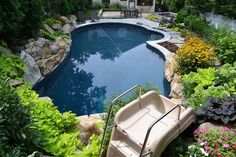 want to see an awesome pool and spa in a small backyard, landscape, outdoor living, ponds water features, pool designs, spas, Pool slide into this vinyl pool and spa