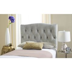 Dress up a guest room or master suite with the deeply tufted Axel twin headboard lavishly upholstered in chic arctic grey. With posh button-tufting, this comfortably padded, gently curved classic headboard evokes images of 1930s Hollywood glamour.