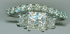 .36 carat trapezoid diamonds in 14 ktl white gold engagement ring. The center diamond is a 1.02 carat princess cut, D color, SI1 clarity. The curved wedding ring has .48 carat in round diamonds.   #engagementrings   www.facebook.com/middiajewelry