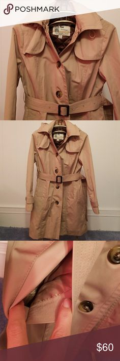 """LOWEST London Fog Heritage hooded trench coat Practically new London Fog Heritage hooded trench coat. Removable button -in vest, side pockets, adjustable and removeable hood, matching belt. labeled PL, but I'd say it is more of a medium. Please refer to measurements and compare to your jackets for fit; when buttoned laid flat 19.75"""" underarm to underarm, 17"""" shoulder seam to shoulder seam, arm length from shoulder seam 23.5"""", 19.25"""" across waist, hip open to about 23"""", length 35.5"""" long. One…"""