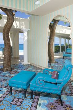 not my color scheme, but love the spirals in the chair echoing the ripples in the tree trunks. love the cut-out in the divider wall, all the light, and the proximity of the space to the sea.