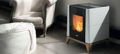 The Aria wood pellet stove stands out with its stylish and compact shape with a ceramic coating and hand crafted solid oak base.It's silent running stove. Convection Stove, Aries, Wood Pellet Stoves, Wood Pellets, Stove Fireplace, Solid Oak, Interior Inspiration, Sweet Home, Ovens