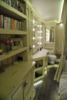 Kellie Pickler's Tour Bus, A bookcase where Kellie Pickler keeps her favorite books to read in her tour bus, as featured in HGTV's Celebrity Motor Homes. © 2011, HGTV/Scripps Networks, LLC. All Rights Reserved.  Kellie's Official GACTV.com Photo Gallery >>  For more on HGTV's Celebrity Motor Homes,