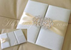 Wedding silk folios with large brooches are just perfect for your wedding. Why? They are ways more luxury and elegant than any commonly used paper invitation folder or box.