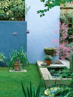 Architectural Walls Used in Garden Design. Why couldn't you do an acid stained concrete wall?