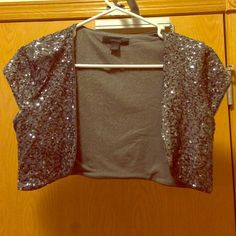 Cropped, silver sequenced top from Express. M M gorgeous cropped, sequenced top in silver and gray from Express. In excellent condition and hardly worn. Great to dress up an outfit! Definitely willing to bundle and offers are welcome! Express Tops
