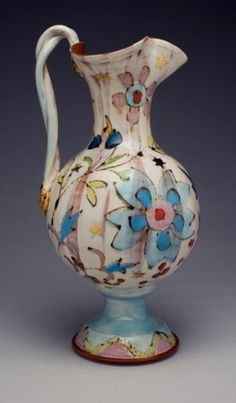 Ursula Hargens Ceramics - majolica glaze look on terra cotta clay body, nice hand drawn line quality and watercolor effect