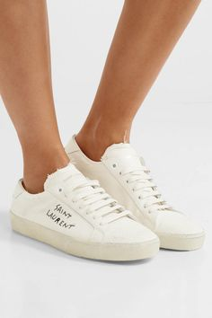 1059030daac6 Saint Laurent - Court Classic leather-trimmed distressed cotton sneakers