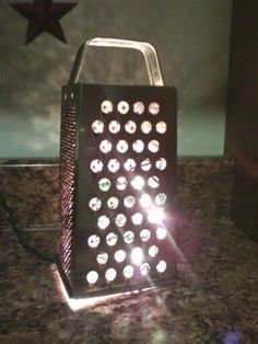 Very simple but I like this for kitchen night light. Place a candle votive or one of those electric candles under the grater, and you have a rustic light for any room in your home.