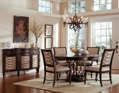 Dining Room Decor Ideas With Antique Pendant Light Above Large Round Table And Wood Flooring Also Using Glass Door