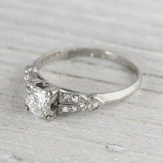 """Found on ErstWhileJewelry $5,200  """"Classic Art DECO vintage engagement ring made in PLATINUM and centered with an approximate .60 CARAT EGL certified old european cut diamond with G-H in color and SI1 clarity. Set in a four prong box setting. Accented with six single cut diamonds on each shoulder, set in a strong horizontal design. Set elegantly low in a very wearable style which will fit perfectly with a wedding band."""""""