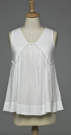 Empire line sleeveless top with lace edging in Swiss voile fabric perfect to beat the heat just for Rs.1299.