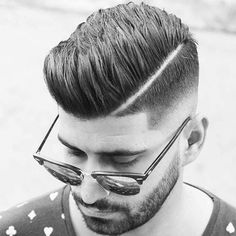 Spiky Comb Over + Hard Part + Mid Skin Fade
