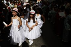 Palestinian Christian girls take part in the Holy Fire procession during Orthodox Easter holiday in the West Bank city of Ramallah, Saturday, April 14, 2012. (AP Photo/Majdi Mohammed)