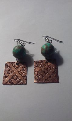 Handmade etched copper with patina