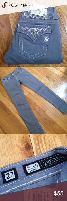 • Miss Me • Miss Me skinny jeans. Slate gray. Very slight discolor in the denim. They were like that when I bought them. I think it will fade with wash wear. Otherwise, excellent like new condition. 31 inch inseam. 98 cotton 2 elastane. Miss Me Jeans Skinny