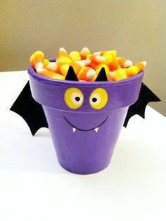 This little bat is about 4 inches in diameter made from an up-cycled flower pot. He has several coats of enamel for indoor/outdoor use. The wings are actually sparkly but you can't really see in the pictures that well. You can choose whether you want a flower pot or candy dish! Perfect for the upcoming Halloween season.  for sale from this link