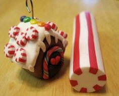 How to make a miniature gingerbread house ornament out of polymer clay: Fimo tutorial. $5.00, via Etsy.